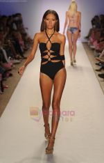 A model walks the runway at the A.Z Araujo AG Uaclara Aquarella Swimwear show during Merecedes-Benz Fashion Week Swim 2012 on July 18, 2011 in Miami Beach, United States (2).JPG