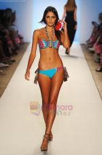 A model walks the runway at the Aguaclara show during Merecedes-Benz Fashion Week Swim 2012  on July 18, 2011 in Miami Beach, United States (1).JPG