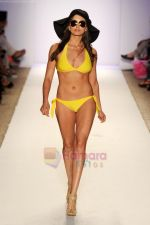 A model walks the runway at the Jogo Beach show during Merecedes-Benz Fashion Week Swim 2012 on July 18, 2011 in Miami Beach, United States (1).JPG