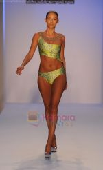 A model walks the runway at the Kooey Swimwear Australia show during Merecedes-Benz Fashion Week Swim 2012 on July 18, 2011 in Miami Beach, United States (3).JPG