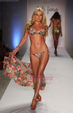 A model walks the runway at the Luli Fama show during Mercedes-Benz Fashion Week Swim 2012 at The Raleigh on July 17, 2011 in Miami Beach, Florida (2).JPG