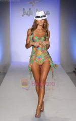 A model walks the runway at the Luli Fama show during Mercedes-Benz Fashion Week Swim 2012 at The Raleigh on July 17, 2011 in Miami Beach, Florida (5).JPG
