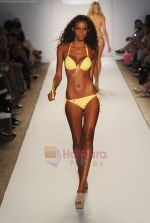 A model walks the runway at the Perfect Tan Bikini show during Merecedes-Benz Fashion Week Swim 2012 on July 18, 2011 in Miami Beach, United States (4).JPG