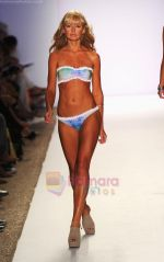 A model walks the runway at the Tavik Swimwear show during Merecedes-Benz Fashion Week Swim 2012 on July 18, 2011 in Miami Beach, United States (2).JPG