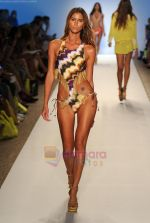 A model walks the runway during the Cia Maritima show at Mercedes-Benz Fashion Week Swim 2012 at The Raleigh on July 17, 2011 in Miami Beach, Florida (1).JPG