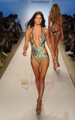 A model walks the runway during the Cia Maritima show at Mercedes-Benz Fashion Week Swim 2012 at The Raleigh on July 17, 2011 in Miami Beach, Florida (4).JPG