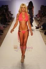 A model walks the runway during the Have Faith Swimwear show at The Raleigh on July 18, 2011 in Miami, Florida (1).JPG