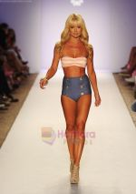 A model walks the runway during the Have Faith Swimwear show at The Raleigh on July 18, 2011 in Miami, Florida (2).JPG