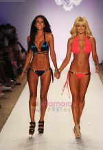 A model walks the runway during the Have Faith Swimwear show at The Raleigh on July 18, 2011 in Miami, Florida (3).JPG