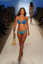 A model walks the runway for the Caffe Swimwear show during Mercedes-Benz Fashion Week Swim 2012 at The Raleigh on July 16, 2011 in Miami Beach, Florida (3).JPG