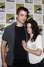 Kristen Stewart, Robert Pattinson poses to promote Breaking Dawn from the Twilight Saga at  the 2011 Comic-Con International Day 1 at the San Diego Convention Center on July 21, 2011 (2).jpg