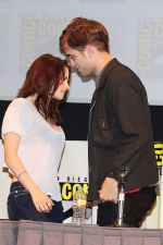 Kristen Stewart, Robert Pattinson poses to promote Breaking Dawn from the Twilight Saga at  the 2011 Comic-Con International Day 1 at the San Diego Convention Center on July 21, 2011 (6).jpg