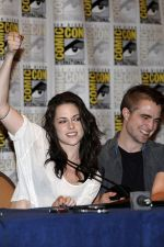 Robert Pattinson, Kristen Stewart poses to promote Breaking Dawn from the Twilight Saga at  the 2011 Comic-Con International Day 1 at the San Diego Convention Center on July 21, 2011 (8).jpg