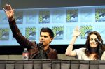 Taylor Lautner, Kristen Stewart poses to promote Breaking Dawn from the Twilight Saga at  the 2011 Comic-Con International Day 1 at the San Diego Convention Center on July 21, 2011 (3).jpg