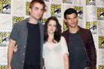 Taylor Lautner, Kristen Stewart, Robert Pattinson poses to promote Breaking Dawn from the Twilight Saga at  the 2011 Comic-Con International Day 1 at the San Diego Convention Center on July 21, 2011 (13).jpg