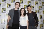 Taylor Lautner, Kristen Stewart, Robert Pattinson poses to promote Breaking Dawn from the Twilight Saga at  the 2011 Comic-Con International Day 1 at the San Diego Convention Center on July 21, 2011 (18).jpg