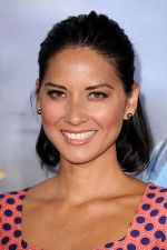 Olivia Munn arrives at the world premiere of the movie Cowboys and Aliens at San Diego Civic Theatre on July 23, 2011 in San Diego, California (2).jpg