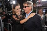 Olivia Wilde and Harrison Ford arrives at the world premiere of the movie Cowboys and Aliens at San Diego Civic Theatre on July 23, 2011 in San Diego, California.jpg