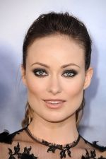 Olivia Wilde arrives at the world premiere of the movie Cowboys and Aliens at San Diego Civic Theatre on July 23, 2011 in San Diego, California (2).jpg