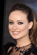 Olivia Wilde arrives at the world premiere of the movie Cowboys and Aliens at San Diego Civic Theatre on July 23, 2011 in San Diego, California (3).jpg