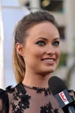Olivia Wilde arrives at the world premiere of the movie Cowboys and Aliens at San Diego Civic Theatre on July 23, 2011 in San Diego, California (6).jpg