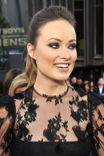 Olivia Wilde arrives at the world premiere of the movie Cowboys and Aliens at San Diego Civic Theatre on July 23, 2011 in San Diego, California.jpg