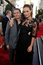Sam Rockwell and Olivia Wilde arrives at the world premiere of the movie Cowboys and Aliens at San Diego Civic Theatre on July 23, 2011 in San Diego, California.jpg