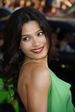Freida Pinto attends the LA Premiere of the movie Rise Of The Planet Of The Apes on 28th July 2011 at the Grauman_s Chinese Theatre in Hollywood, CA  United States (18).jpg