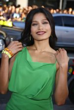 Freida Pinto attends the LA Premiere of the movie Rise Of The Planet Of The Apes on 28th July 2011 at the Grauman_s Chinese Theatre in Hollywood, CA  United States (19).jpg