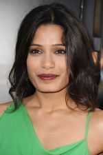 Freida Pinto attends the LA Premiere of the movie Rise Of The Planet Of The Apes on 28th July 2011 at the Grauman_s Chinese Theatre in Hollywood, CA  United States (6).jpg