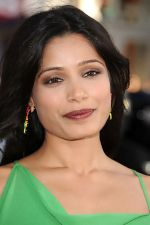 Freida Pinto attends the LA Premiere of the movie Rise Of The Planet Of The Apes on 28th July 2011 at the Grauman_s Chinese Theatre in Hollywood, CA  United States (8).jpg