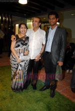 suresh watkar  with wife and  vihang sarnaik at Pratap Sarnaik birthday party in Mumbai on 28th July 2011.JPG