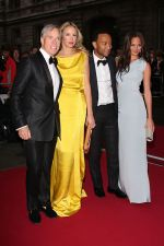 Tommy Hilfiger, Dee Hilfiger, Chrissy Teigen and John Legend attends the GQ Men of the Year Awards 2011 in Royal Opera House on September 06, 2011 (1).jpg