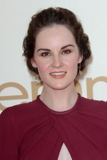 Michelle Dockery attends the 63rd Annual Primetime Emmy Awards in Nokia Theatre L.A. Live on 18th September 2011 (1).jpg