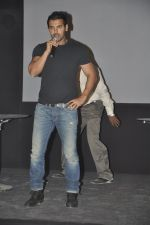 John abraham lifts a bike at Force Promotions in Mehboob, Mumbai on 27th Sep 2011 (18).JPG