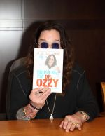 Ozzy Osbourne signs his book _Trust Me, I_m Dr. Ozzy_ at Barnes and Noble at The Grove in Los Angeles on October 15, 2011 (1).jpg