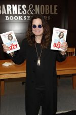 Ozzy Osbourne signs his book _Trust Me, I_m Dr. Ozzy_ at Barnes and Noble at The Grove in Los Angeles on October 15, 2011 (2).jpg