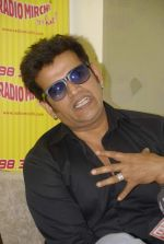 Ravi Kishan with the star cast of Chaalis Chaurasia at Radio Mirchi in Parel, Mumbai on 27th Dec 2011 (23).JPG