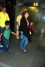 Madhuri Dixit snapped with kids and husband at the airport in Mumbai on 1st Jan 2012 (1).JPG