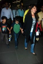 Madhuri Dixit snapped with kids and husband at the airport in Mumbai on 1st Jan 2012 (12).JPG
