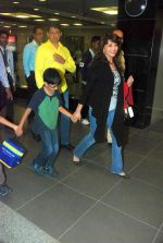 Madhuri Dixit snapped with kids and husband at the airport in Mumbai on 1st Jan 2012 (14).JPG