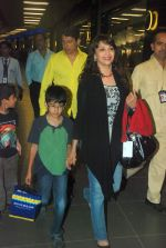 Madhuri Dixit snapped with kids and husband at the airport in Mumbai on 1st Jan 2012 (7).JPG