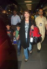 Madhuri Dixit snapped with kids and husband at the airport in Mumbai on 1st Jan 2012 (8).JPG