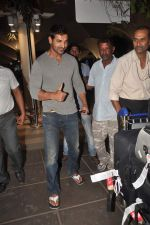 John Abraham snapped at the airport in Mumbai on 4th Jan 2012 (13).jpg
