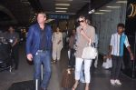 Liz Hurley snapped with Shane Warne at Mumbai airport on 1st June 2012 (27).JPG