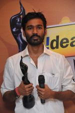 Dhanush received  the Best Actor Award Male for the Movie _Aadukalam_, at the _59th !dea Filmfare Awards 2011_ (South) on 8th July at Jawaharlal Nehru indoor stadium, Chennai...jpg