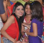 Sherlyn Chopra First Indian Playboy Cover Girl turns Santa for street kids of The Ray of Hope NGO in Mumbai on 16th Dec 2012 (10).JPG