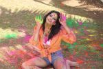 Rozlyn Khan at the Holi reloaded event with the International fame musician DJ Juno Reacto  (1).jpg