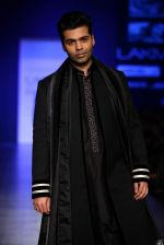 Karan Johar walk the ramp for Manish Malhotra Show at Lakme Fashion Week 2013 Day 1 in Grand Hyatt, Mumbai on 22nd March 2013 (8).JPG