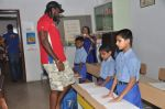 Chris Gayle spend time with NGO kids in Worli, Mumbai on 26th April 2013 (32).JPG